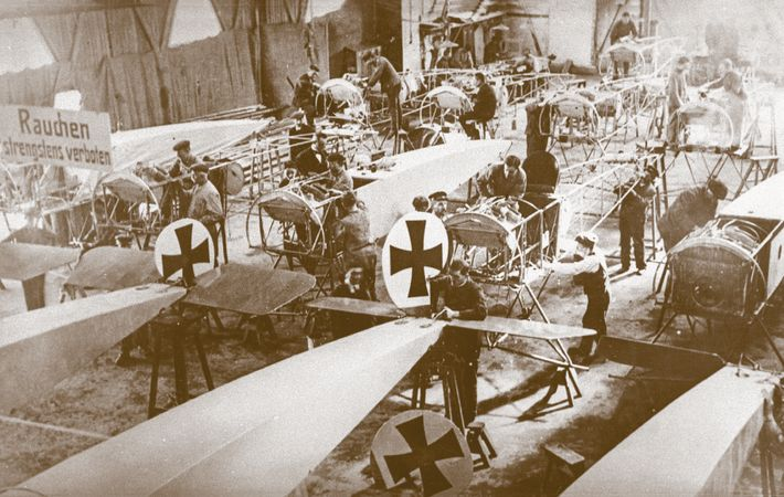 In this undated photograph, workers at the Fokker plant near Berlin assemble the Eindecker III, a ...