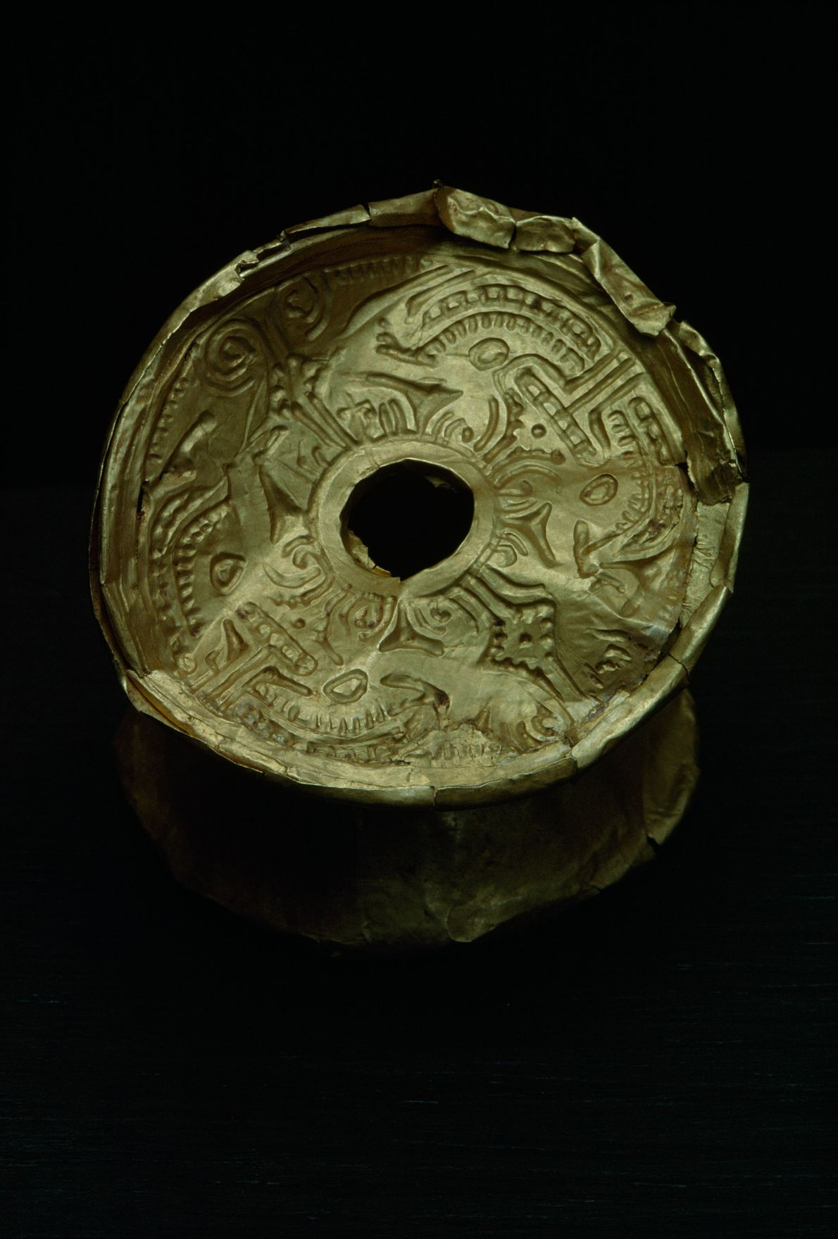 This gold object is probably from the pre-Columbian Calima culture, an archeological region on Colombia's Pacific ...