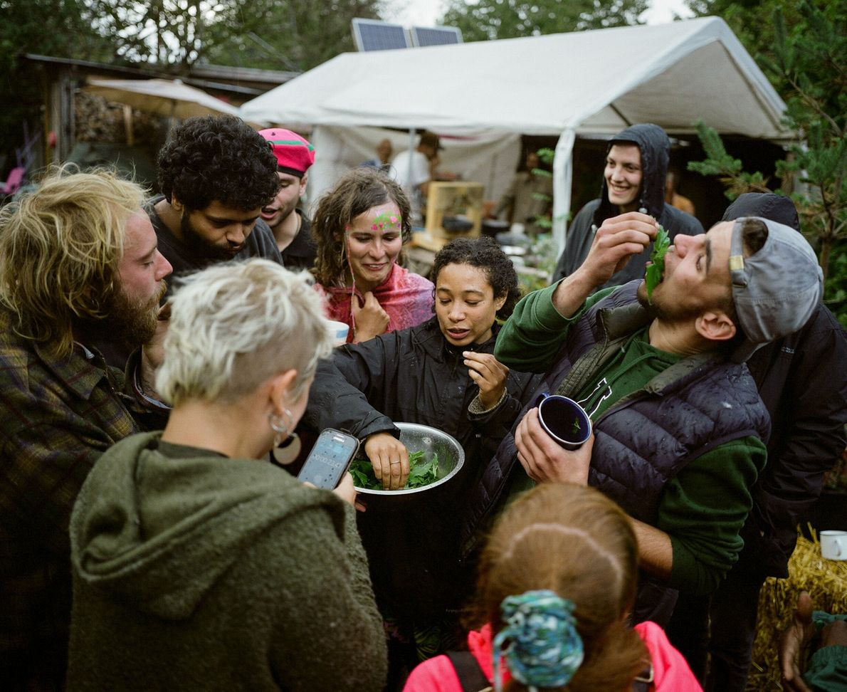 Grow Heathrow residents participate in a nettle-eating competition during a harvest festival. Community events, especially those ...