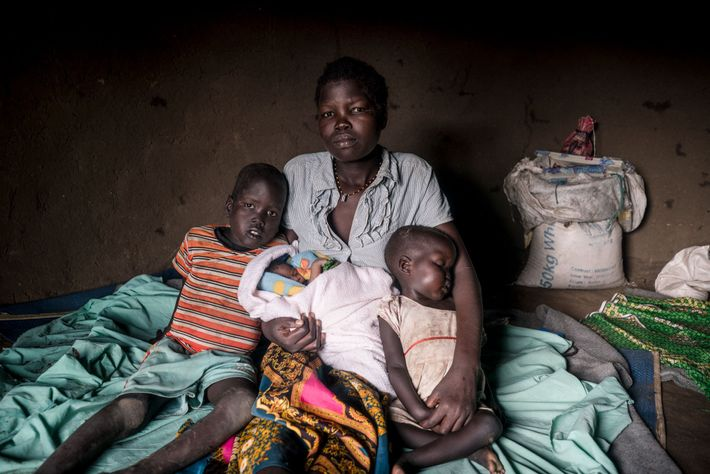 Mary Nakany sits with her children, each born during different stages of South Sudan's ongoing conflict.
