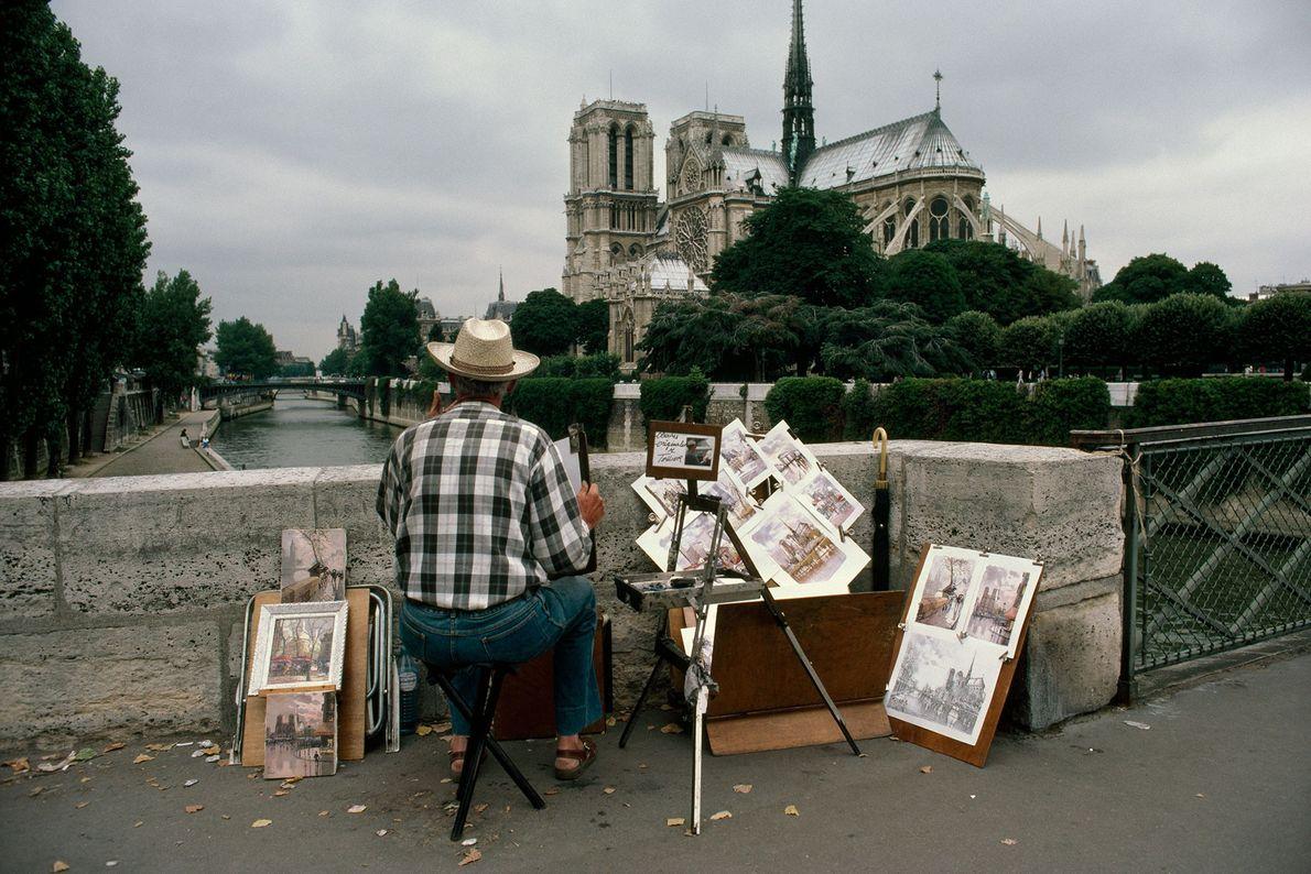 An artist views Notre Dame from the Pont de L'Archeveche.