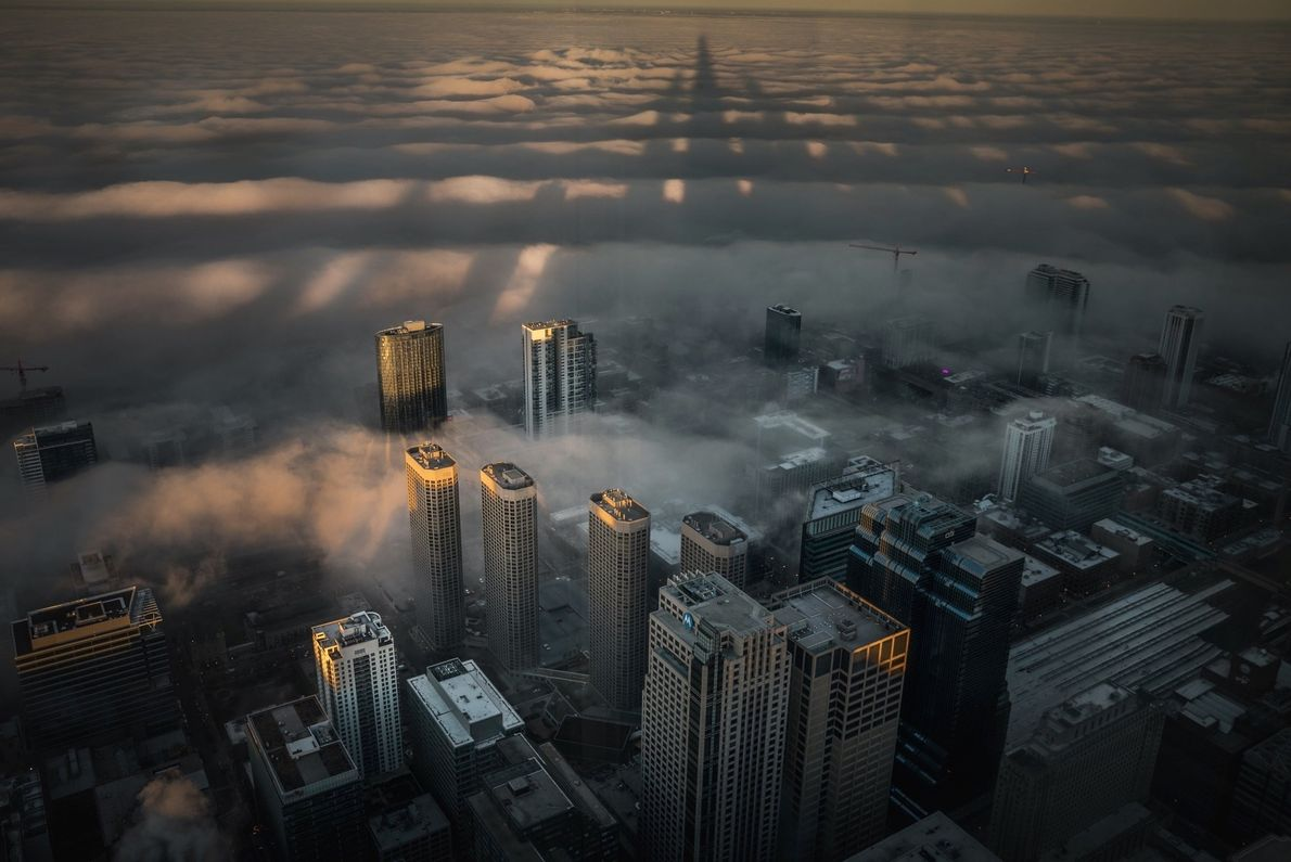 """""""During sunrise on Decemeber 15, from the 103rd floor of the Sears Tower in Chicago, Illinois,"""" ..."""