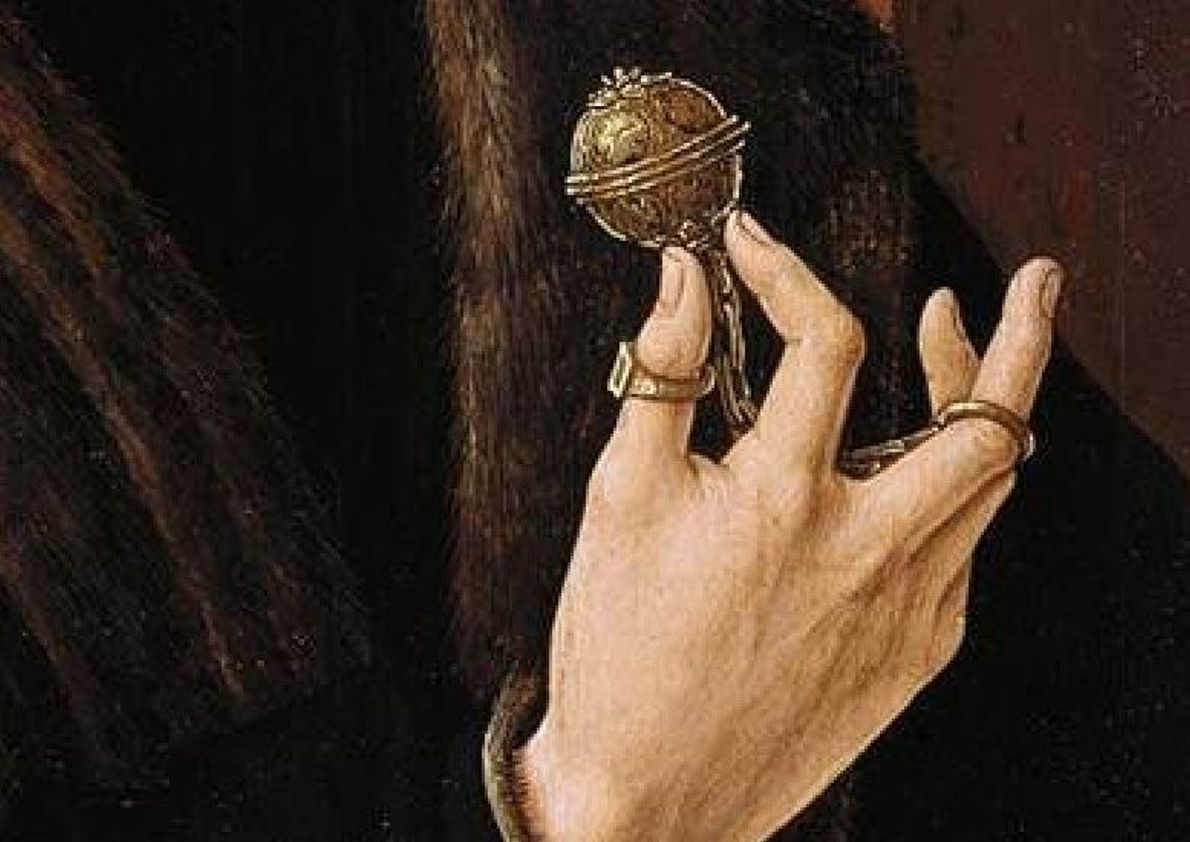 A man holds a similar pomander in this detail from a 1518 painting by Jacob Cornelisz ...