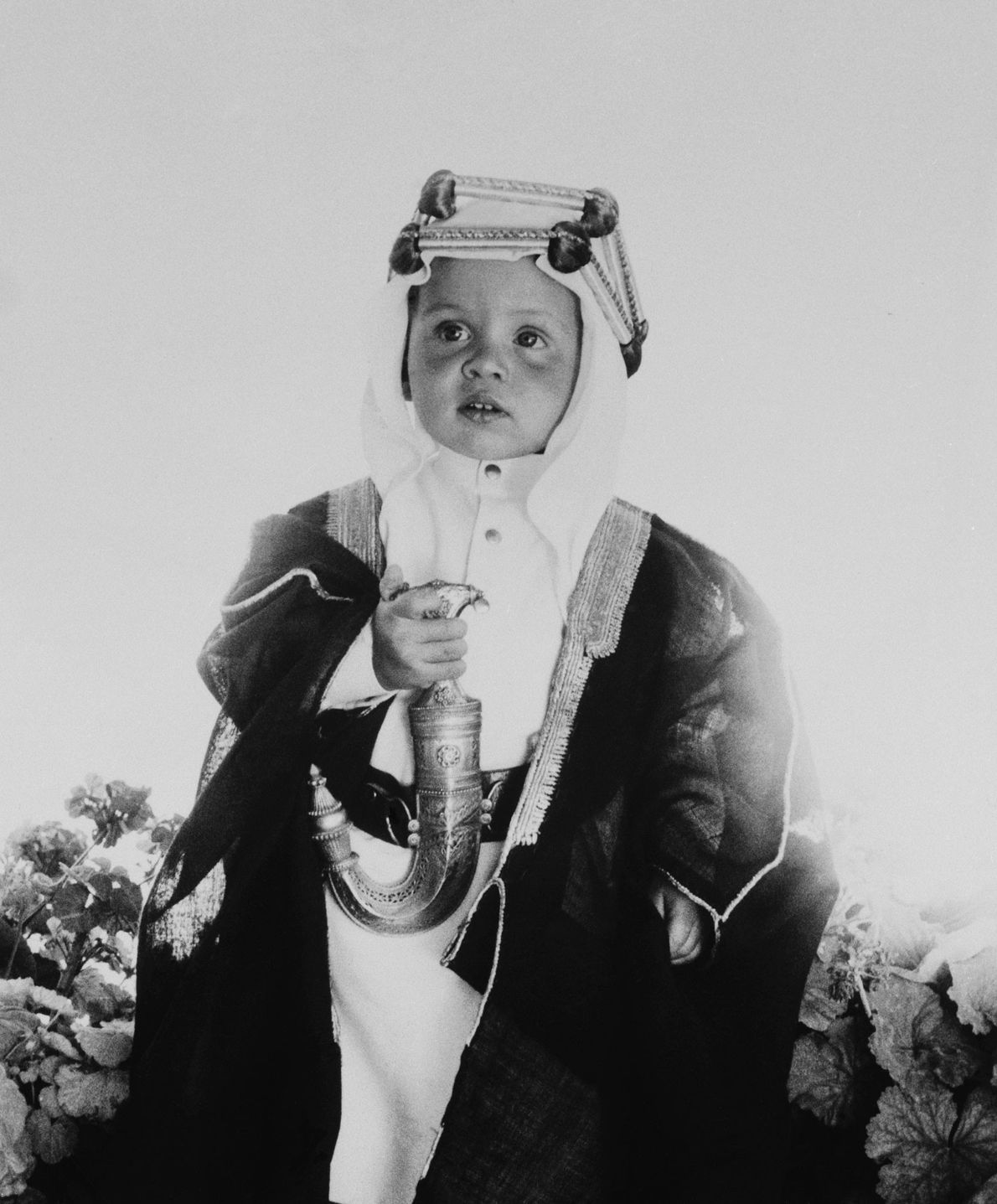 Crown Prince Abdullah II, then one year old, of the Hashemite Kingdom of Jordan poses with ...