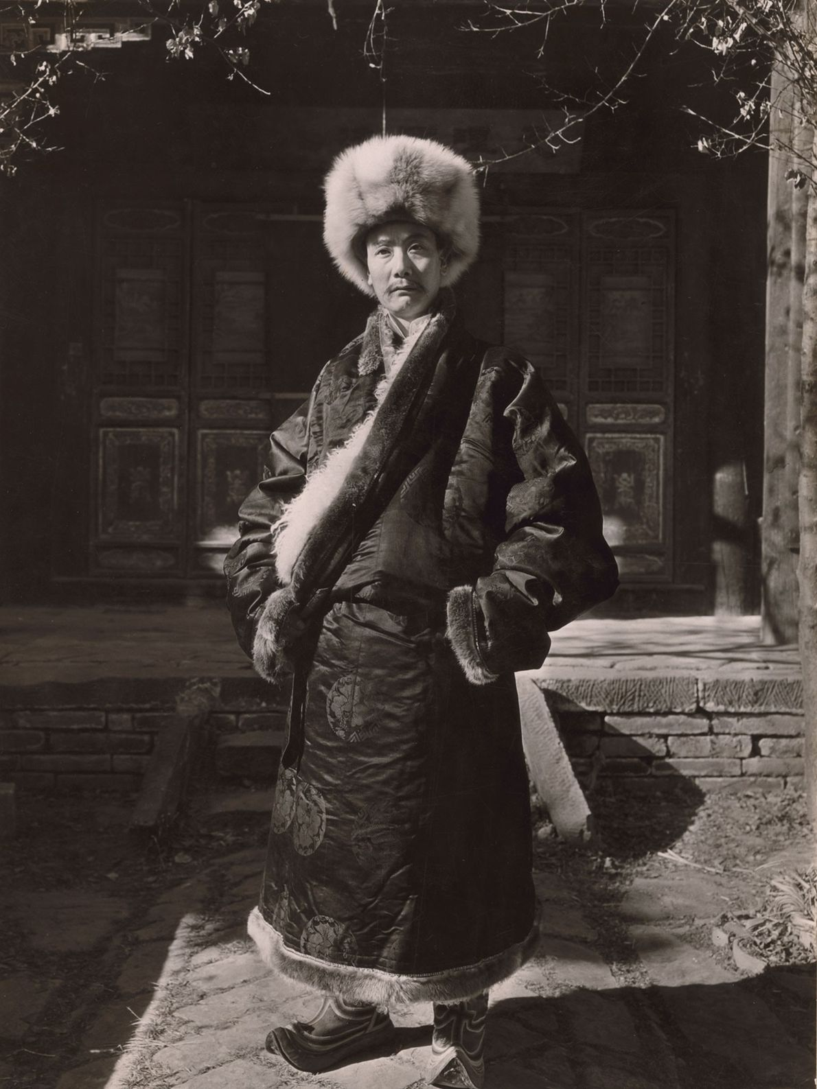 A Choni prince wears traditional attire in China.