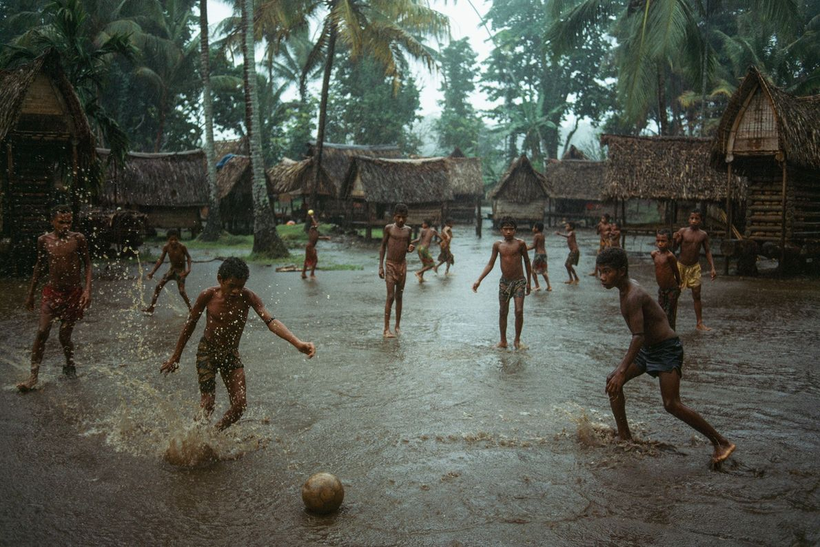 In Kiriwina Island, the largest of the Trobriand Islands in Papua New Guinea, boys play football ...