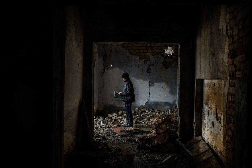 Nikita, 12, inside a school shelled in 2014 and since abandoned in Nikishino, in the Donetsk ...