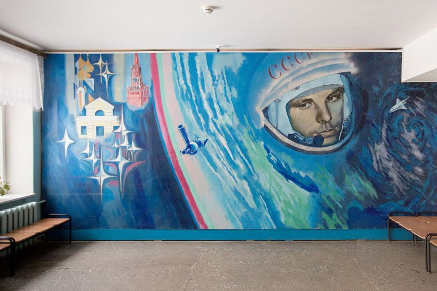 A mural featuring Yuri Gagarin brightens up the wall of a local school.