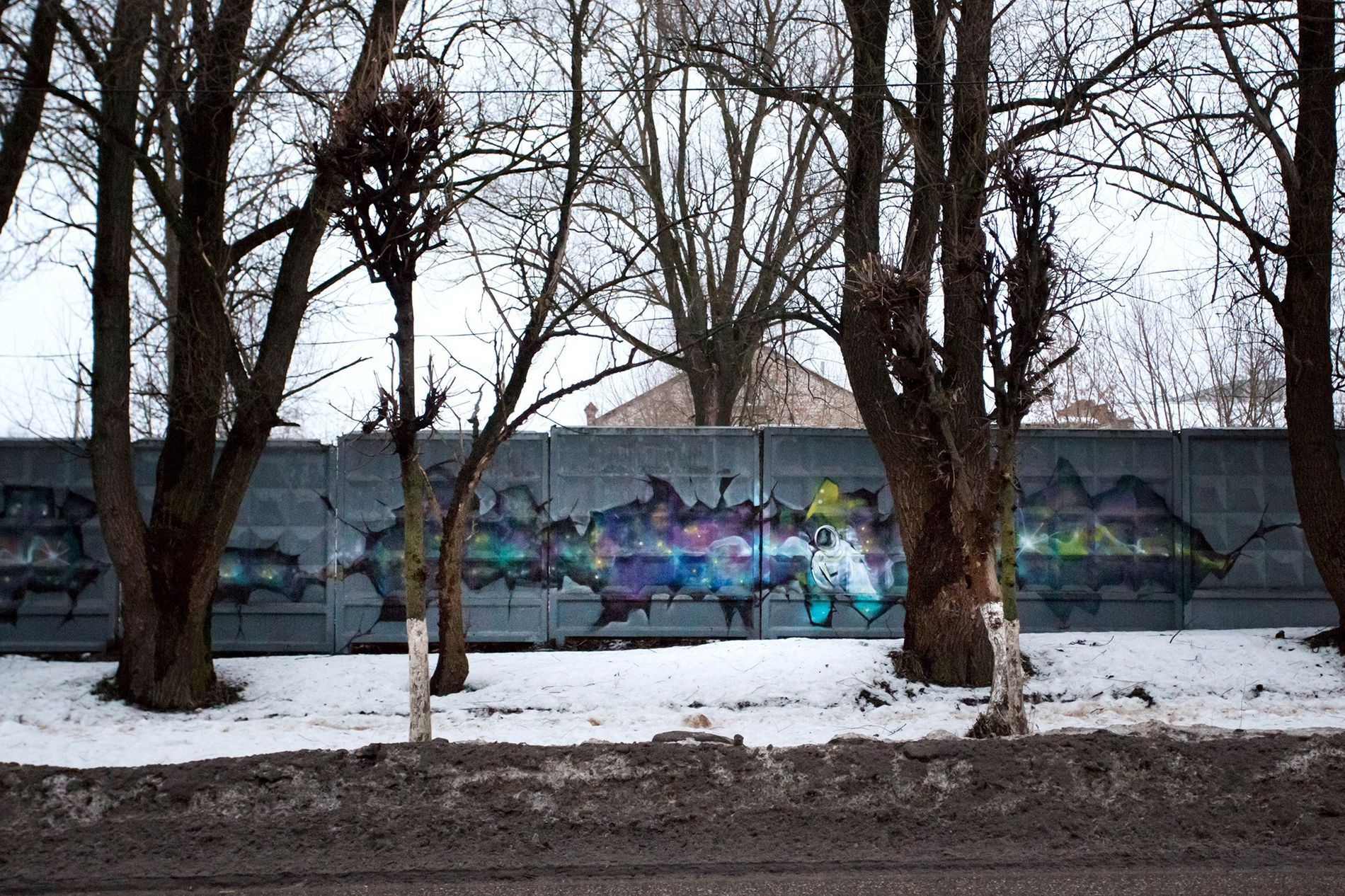 Space-themed graffiti decorates a concrete fence on Gagarin Street in the Russian town of Gagarin.