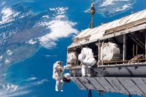 Astroanuts take a spacewalk outside the International Space Station, which has been continuously occupied by rotating ...