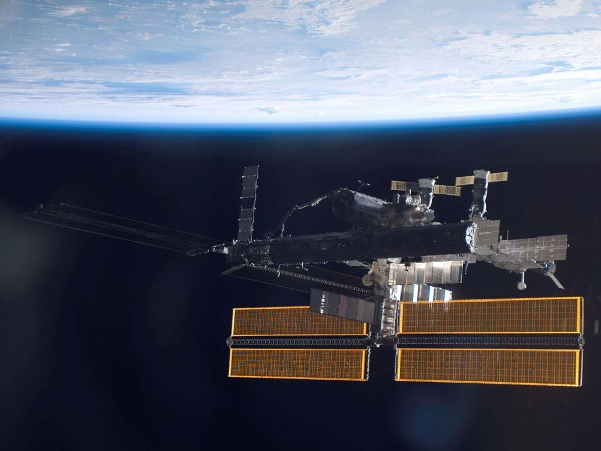 This view of the International Space Station over a blue-and-white Earth was taken shortly after the ...