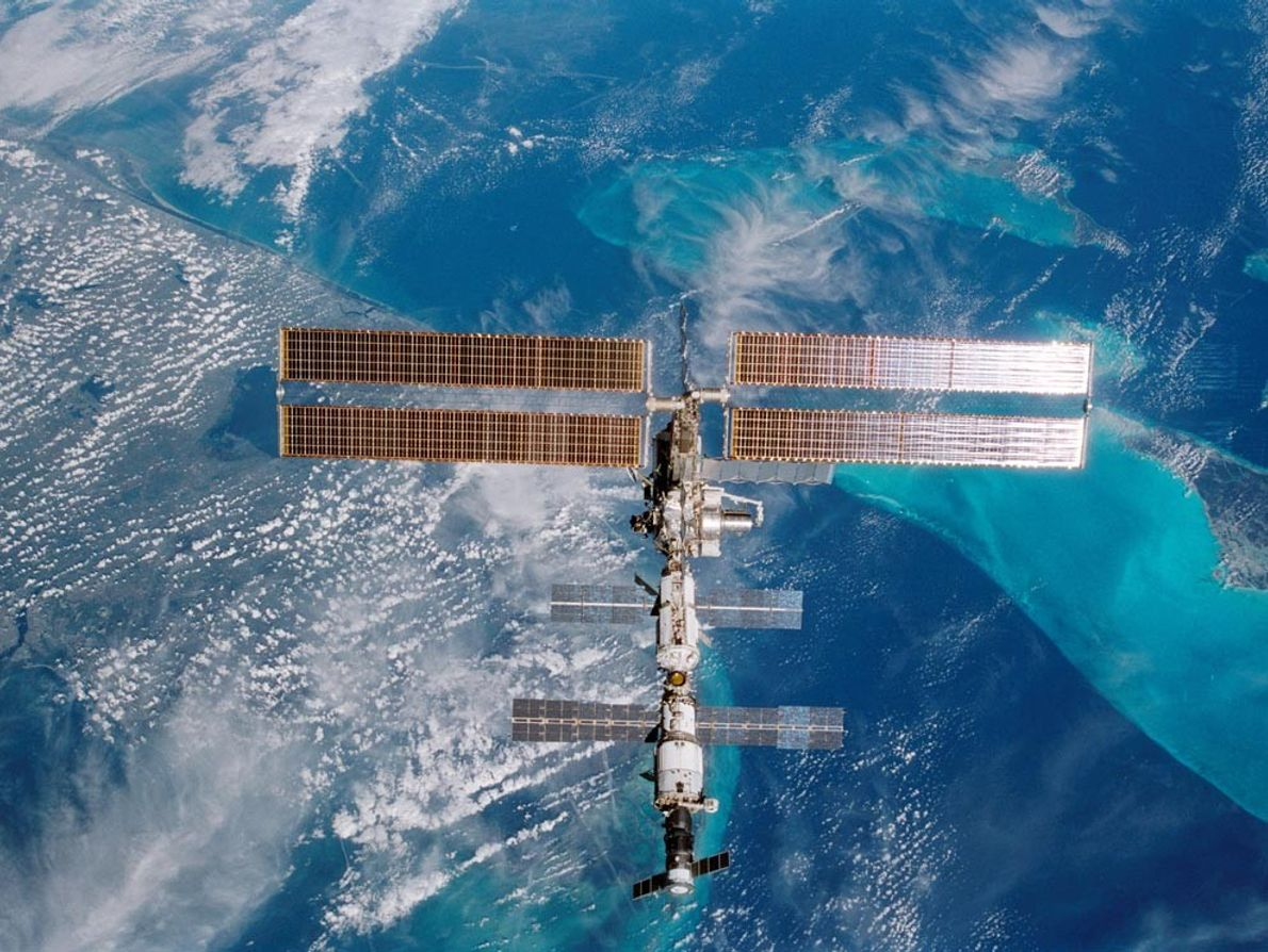The turquoise waters of Miami, Florida, gleam underneath the International Space Station as it floats some ...