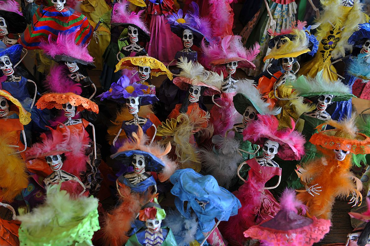Day of the Dead 'La Catrina' skeletons on display in a shop in Guadalajara, Mexico.