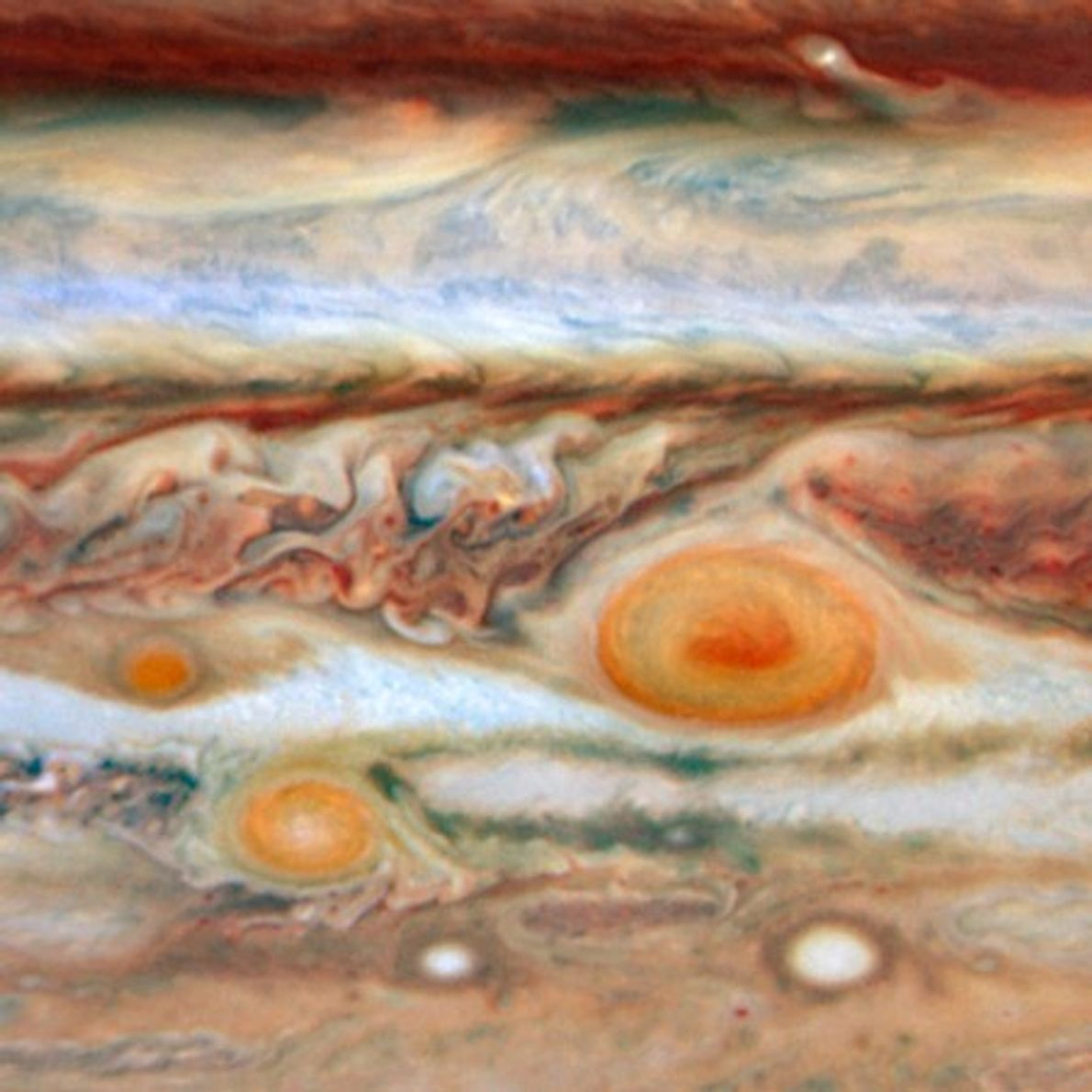 A view of Jupiter taken by Hubble in May 2008 shows a new red spot (far ...