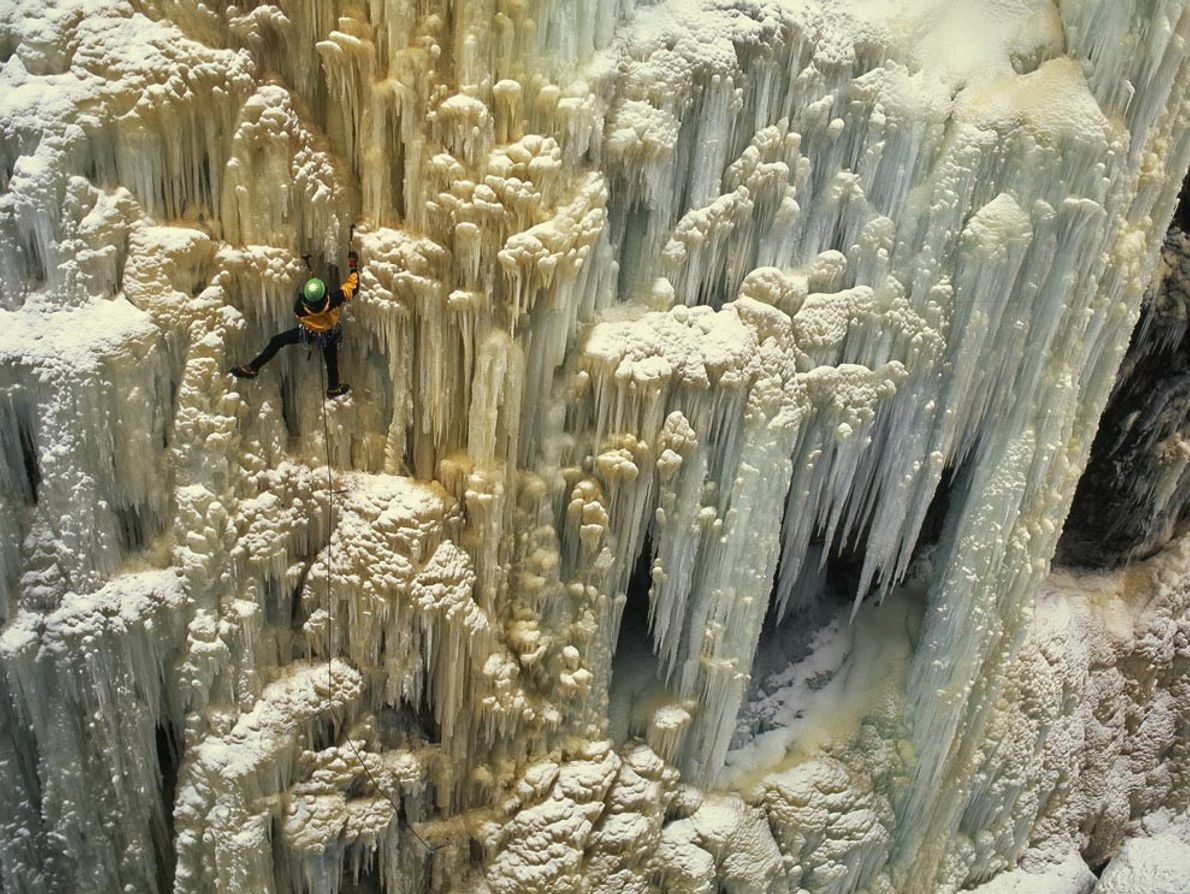 Climbing ice-encrusted limestone is careful work in Box Canyon in Ouray, Colorado. During the summer a ...