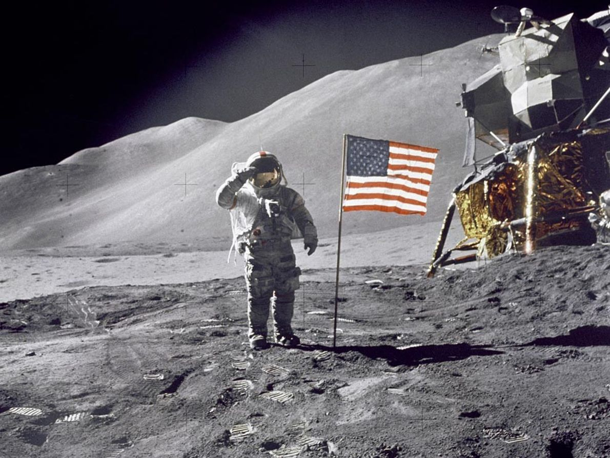 With lunar module Falcon gleaming in the background, Apollo 15 Commander Dave Scott salutes the American ...