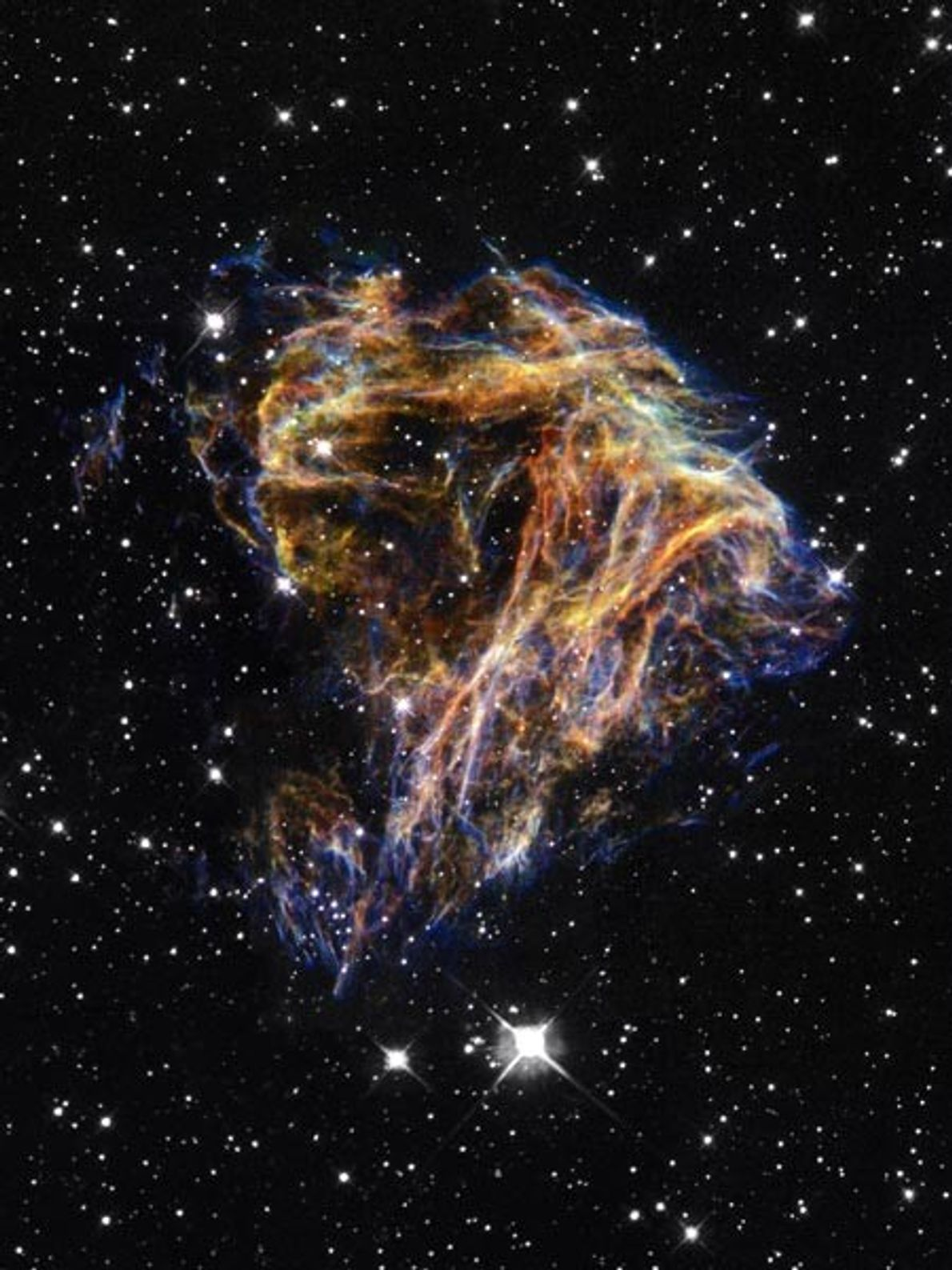 Sheets of debris from an exploded star swirl in the Large Magellanic Cloud (LMC) galaxy in ...