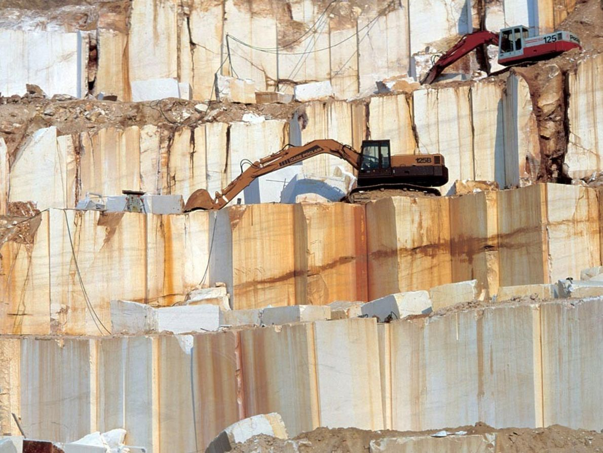 Bulldozers work in a marble quarry in Thásos, Greece. The Earth's heat and pressure alter limestone ...