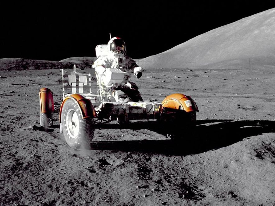 Apollo 17 mission Commander Eugene Cernan checks out the lunar roving vehicle (LRV) at the Taurus-Littrow ...