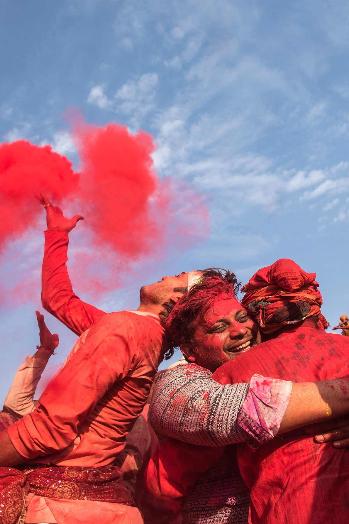 People hit the streets with sacs of gulal, which is showered on friends, family and strangers. ...