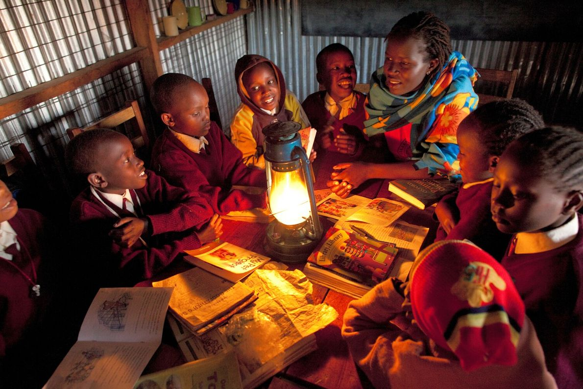 Picture of Kakenya Ntaiya, a teacher in Kenya, reading with a group of fourth-grade girls.