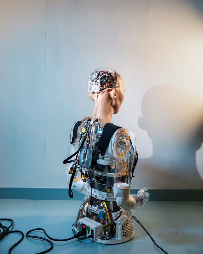 Seeing Sophia from behind offers a glimpse at the robot's technological complexity.