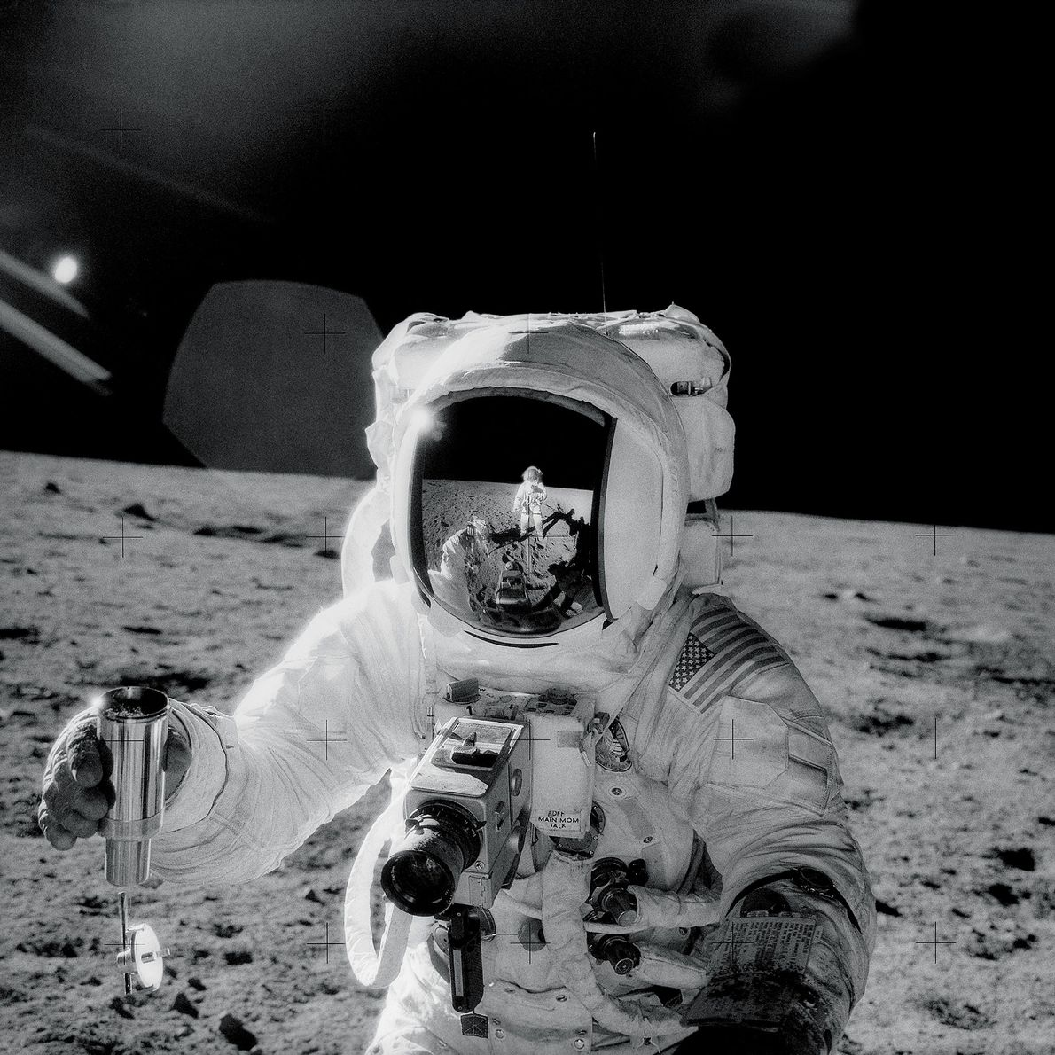 During the Apollo 12 mission in 1969, astronaut Charles Conrad captured this selfie reflected in fellow ...