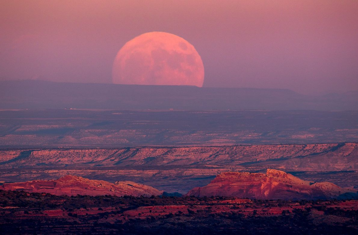 The November 2016 supermoon hangs above the Valley of the Gods near Mexican Hat, Utah.