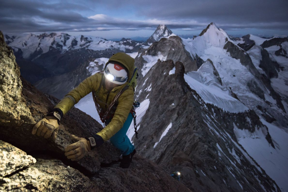"""""""Liv Sansoz at dawn on the excellent rock ridge 'Rothorngrat' of the Zinalrothorn on what turned ..."""