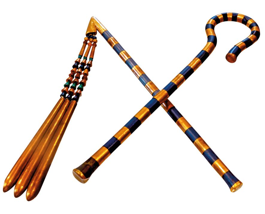 The flail and scepter found in the tomb of the boy king, Tutankhamun. The flail was ...