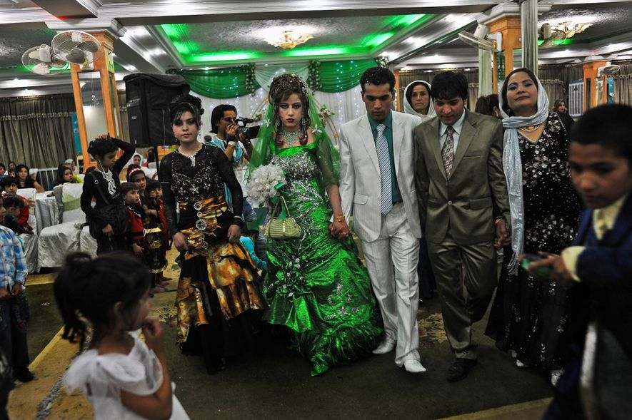 At this wedding in Kabul, Afghanistan, the bride wore green, which is associated with prosperity and ...