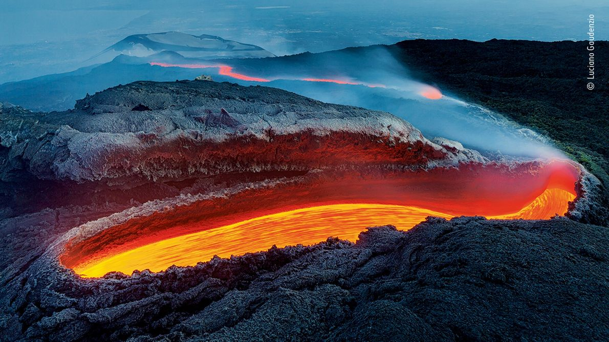 Italy's Luciano Gaudenzio photographed lava flowing from a crevice in Mount Etna. The image won the ...