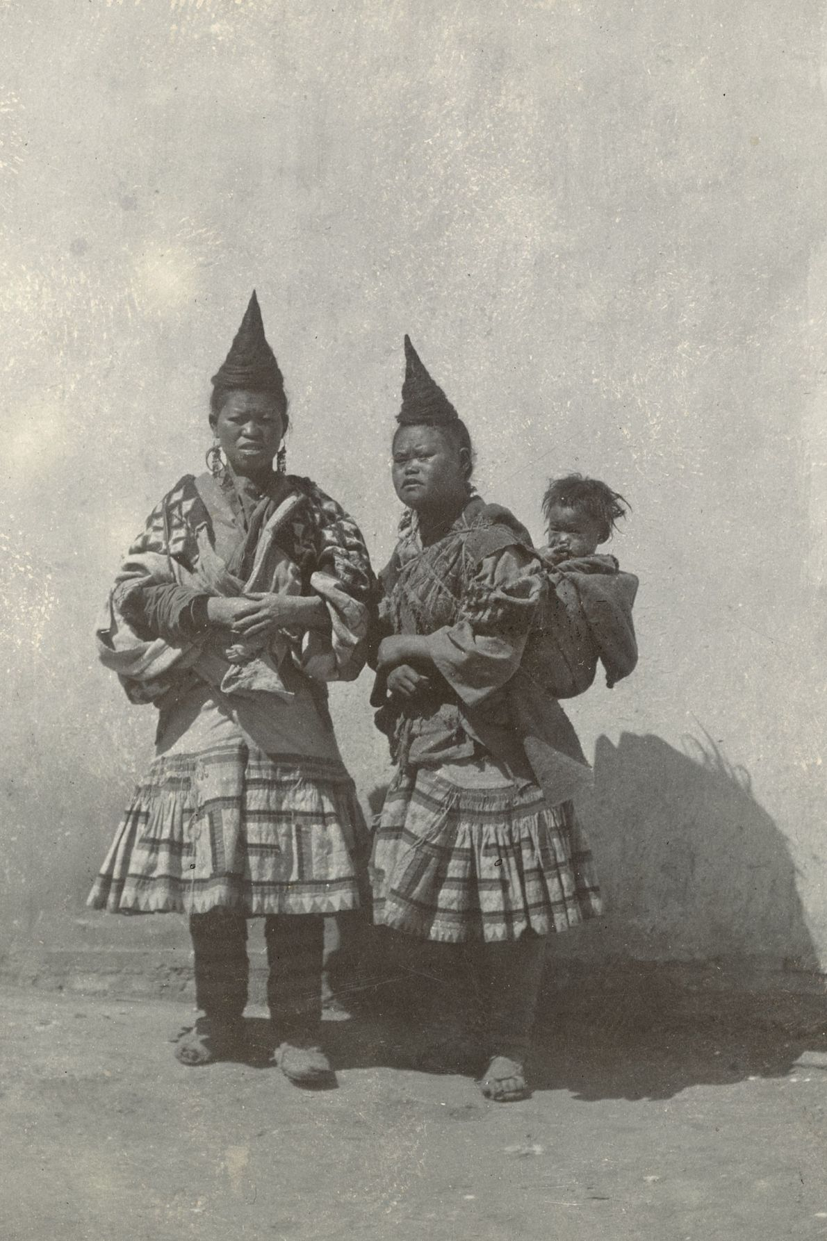 In the Yunnan Province, China, the horn-shaped hairstyle these women are wearing indicates they have had ...