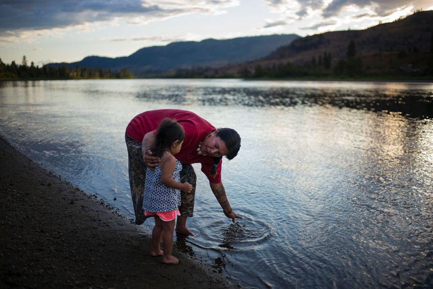 Kanahus Manuel brings her niece Wasayka, 2, to the banks of the South Thompson River in ...