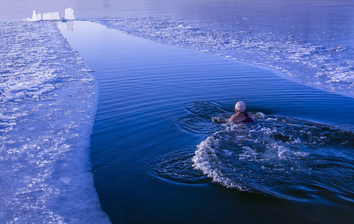 Your Shot photographer Wang Wei photographed a swimmer in icy waters.