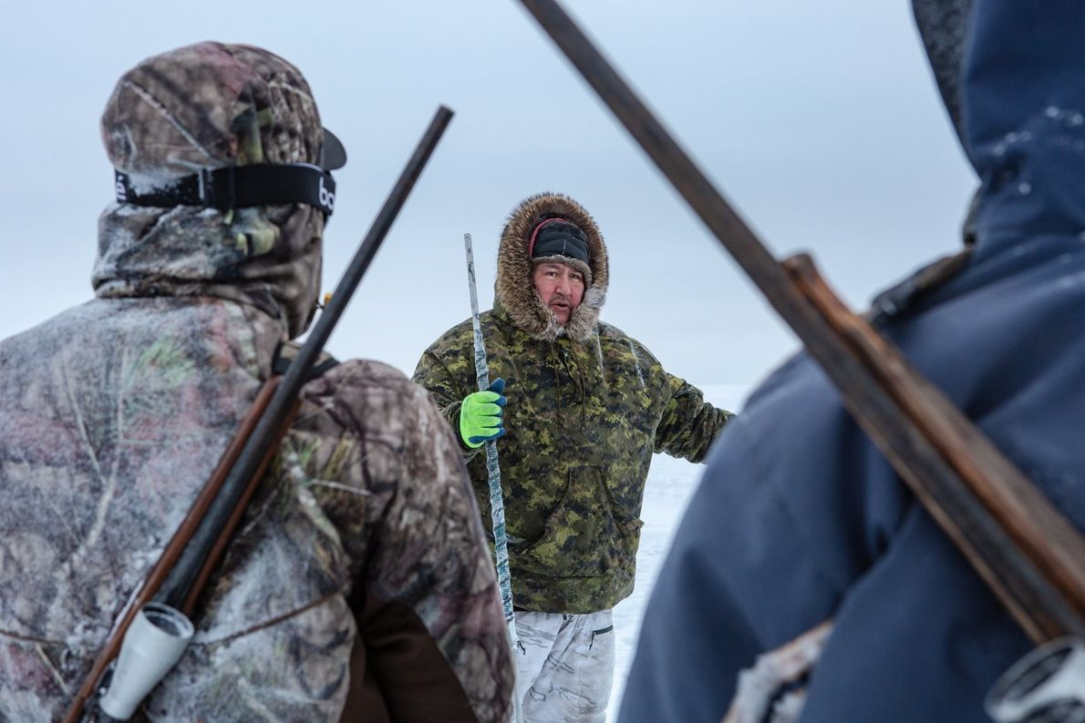 """Young Inuit hunters learn the necessary skills for trapping animals and ice safety from elders in ..."
