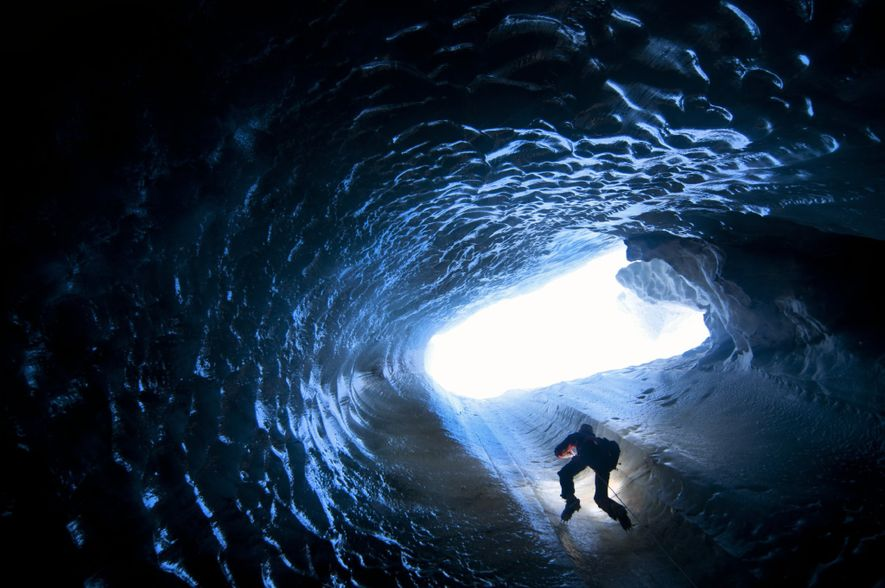 """""""Dr. Matt Covington climbs a thin, nylon rope to exit a glacier moulin in Svalbard. Moulins …"""