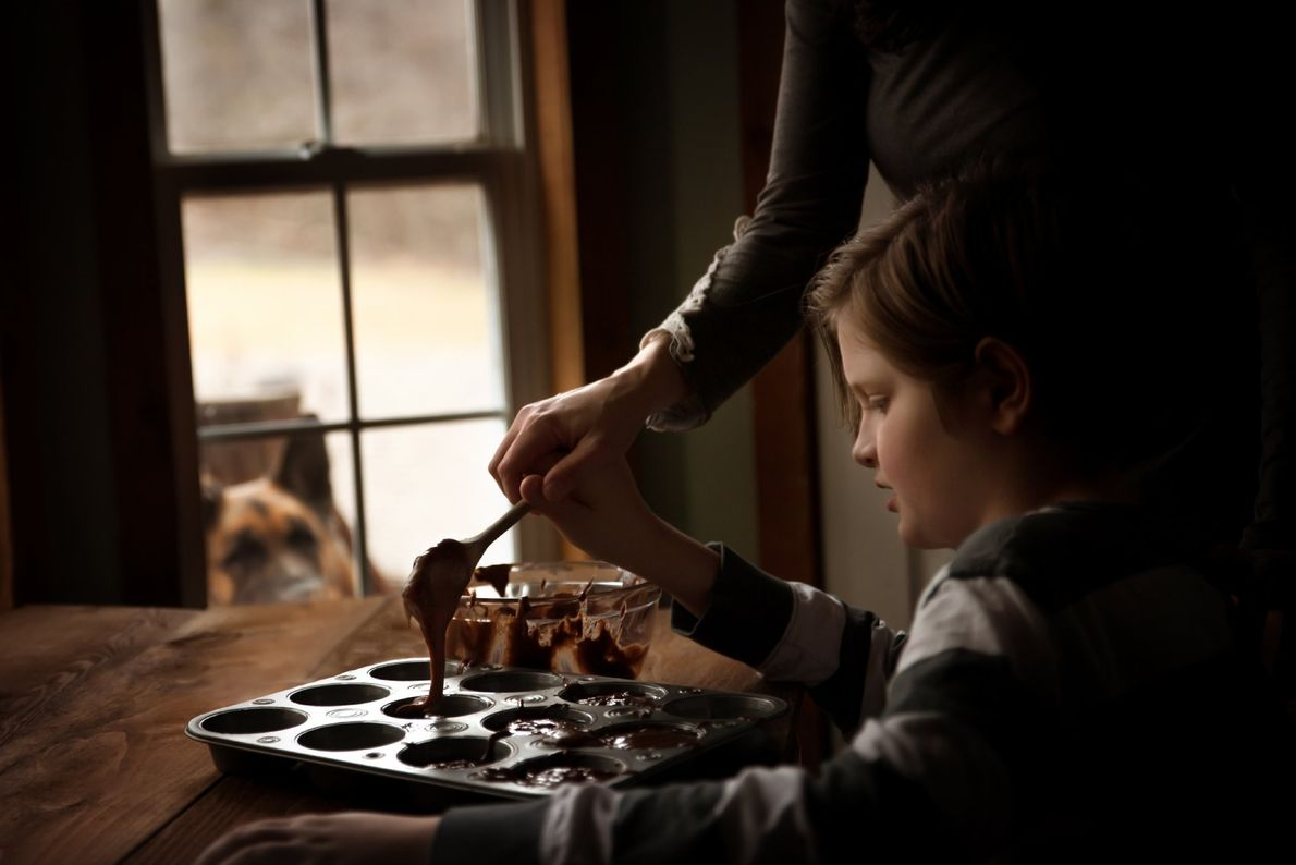 Your Shot photographer Lyndsay West documented this scene while making brownie muffins with a canine onlooker ...