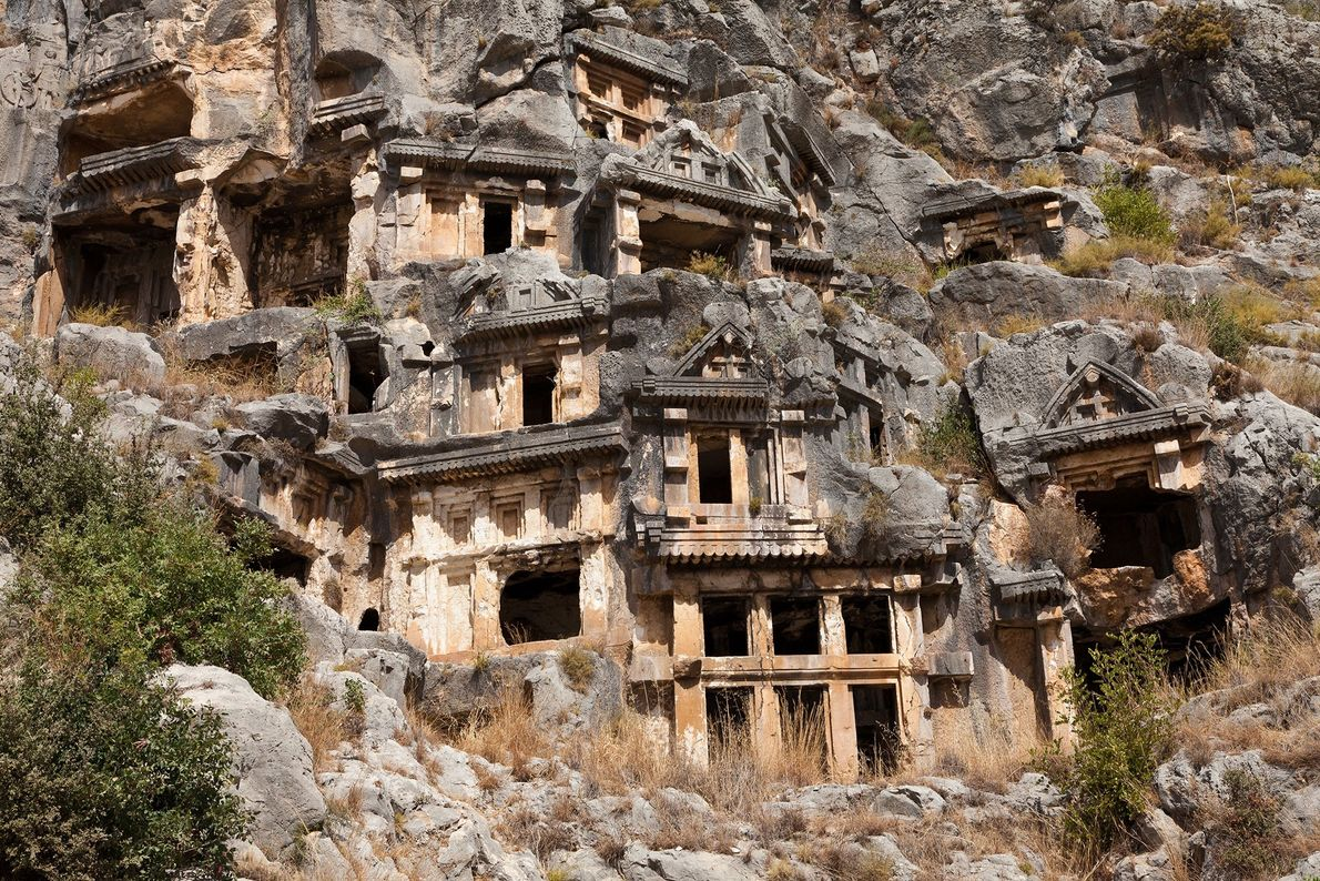 Intended as elaborate houses for the afterlife, the tombs of the Myra necropolis were carved by ...