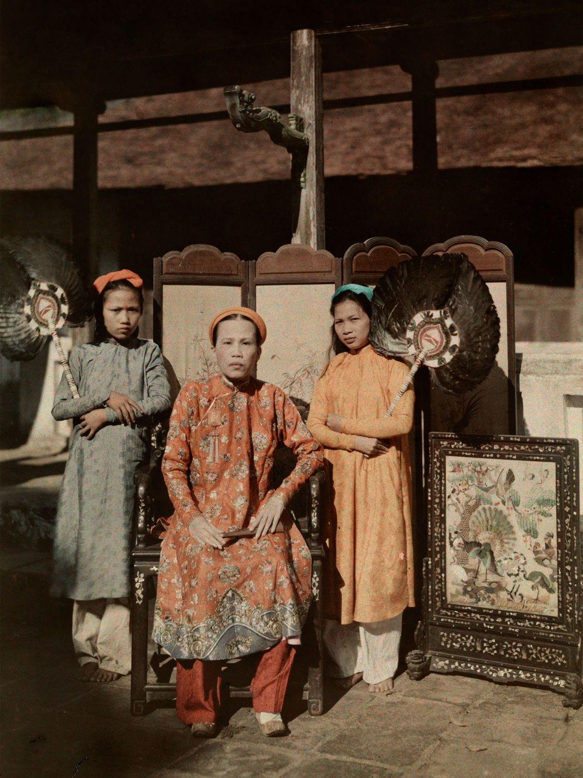 A princess of Hue wears her royal robes in Annam, French Indochina. Hue was the imperial ...