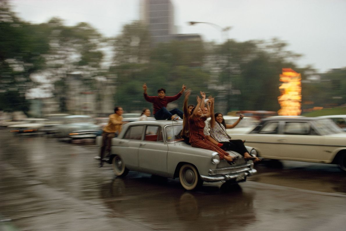 Locals celebrate a victorious soccer match in the streets of Mexico City, Mexico, in 1973.