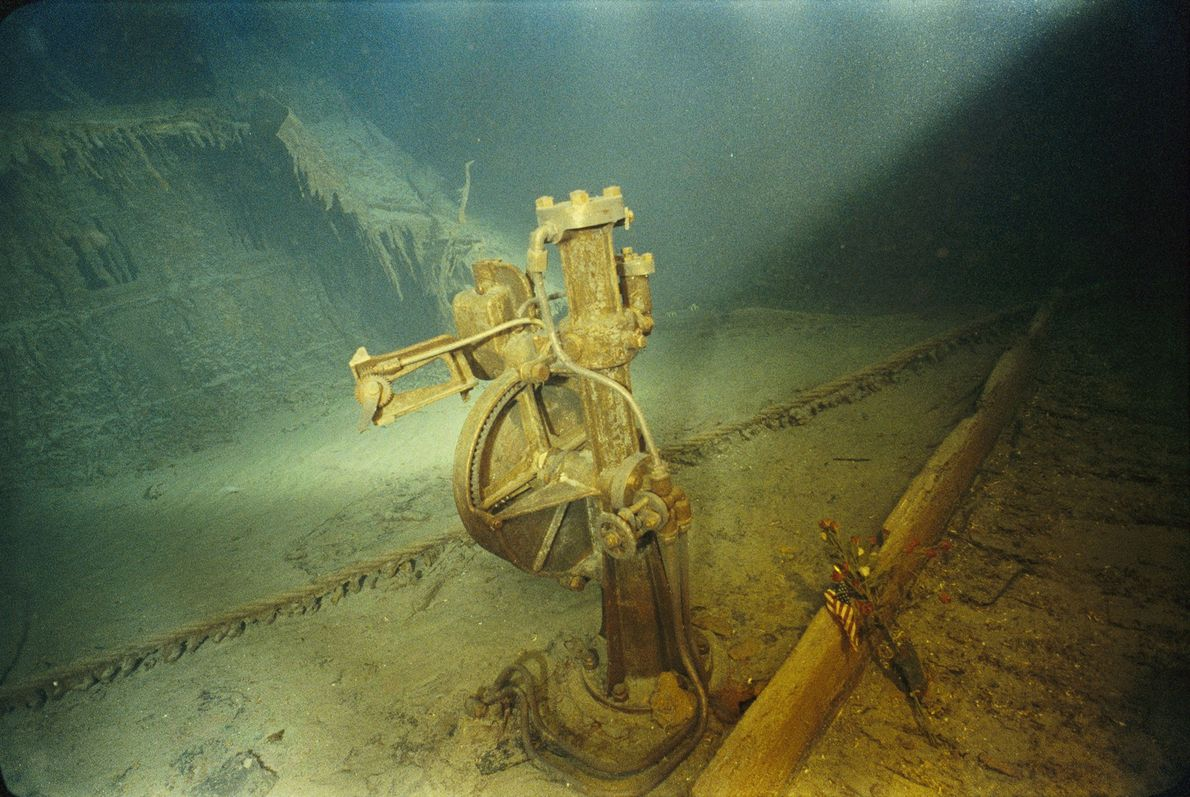 The telemotor that once held the ship's wheel remains mostly intact due to its bronze build.