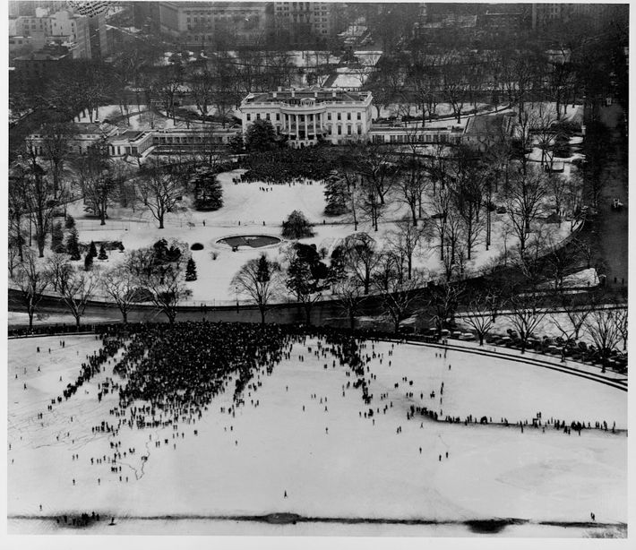 A crowd gathers around the White House to attend President Roosevelt's more intimate fourth inauguration—the first ...