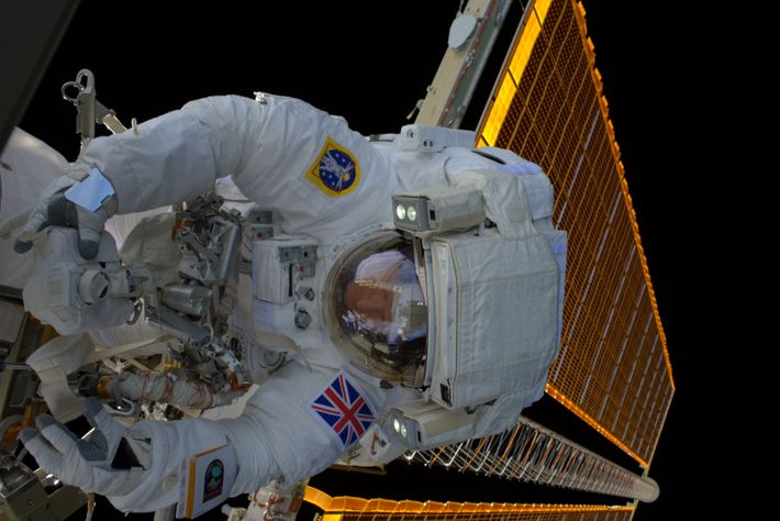 ESA astronaut Tim Peake during a 4 hour 43 minute spacewalk to replace a failed power regulator ...
