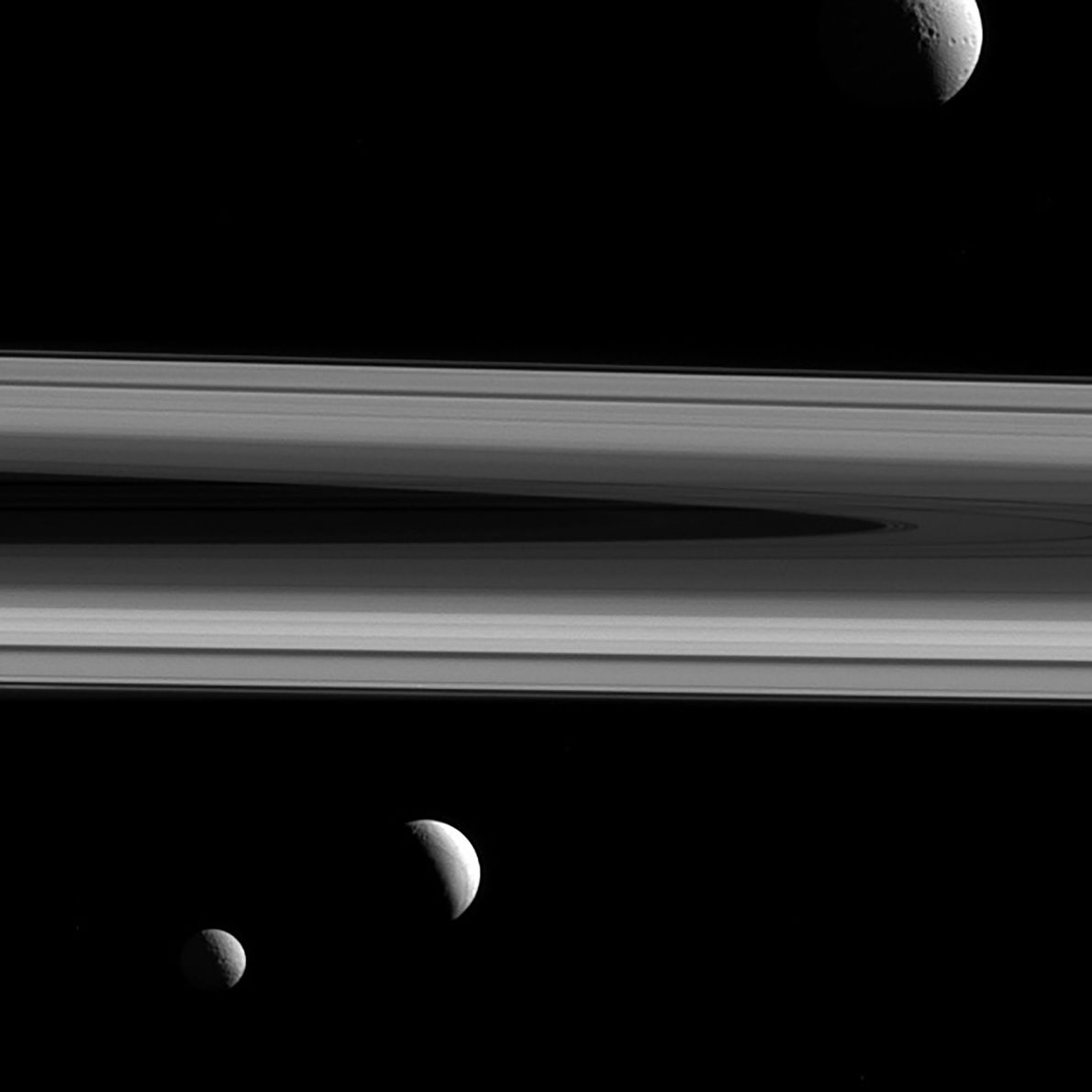Three of Saturn's moons—Tethys, Enceladus, and Mimas—appear in a group photo taken by Cassini.