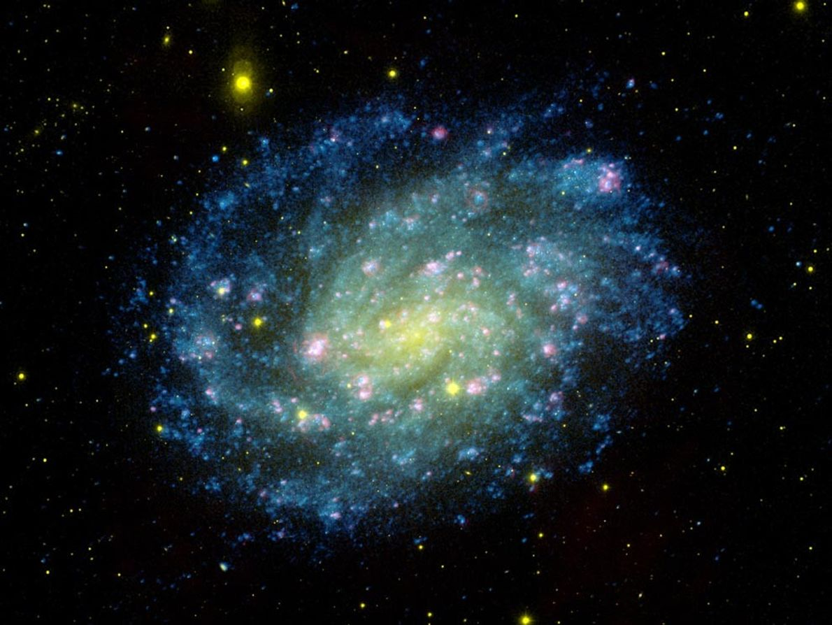 A colour-composite image shows the NGC 300 galaxy, a spiral galaxy like the Milky Way located ...