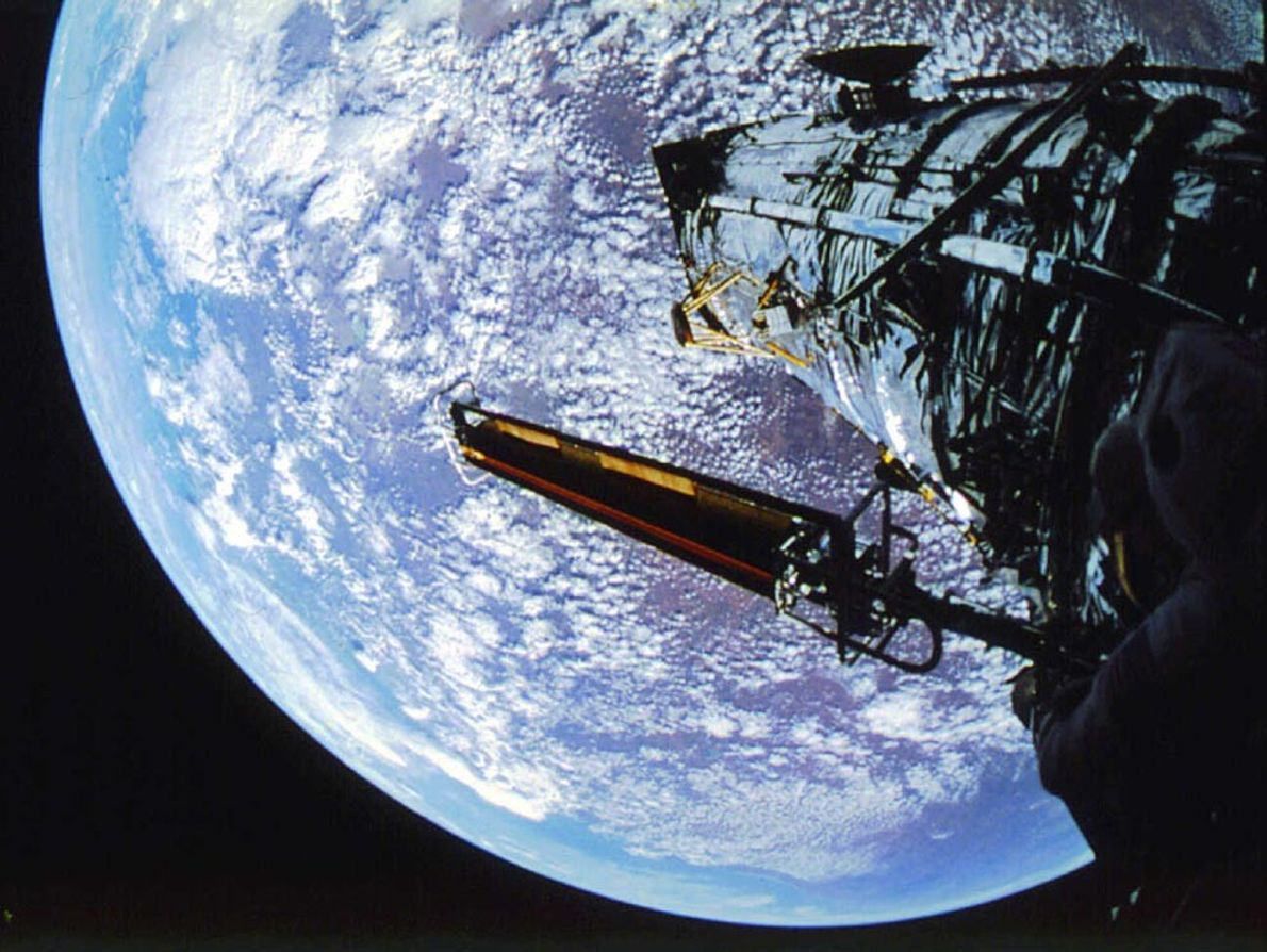 During the first Hubble servicing mission in December 1993, astronauts installed new solar arrays (left) designed ...