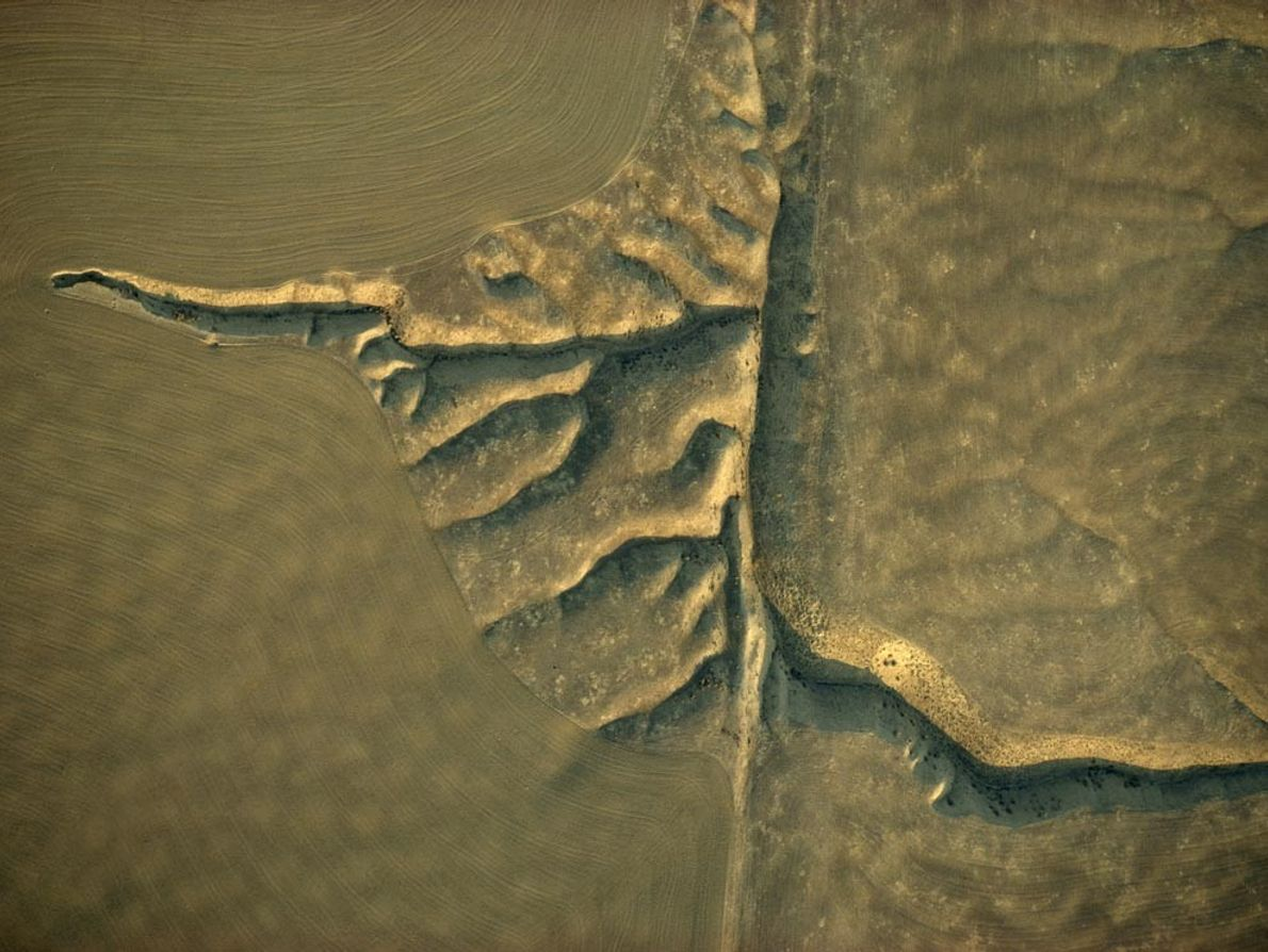 Offset streams cut into the Carrizo Plain along the San Andreas Fault in California. The fault, ...