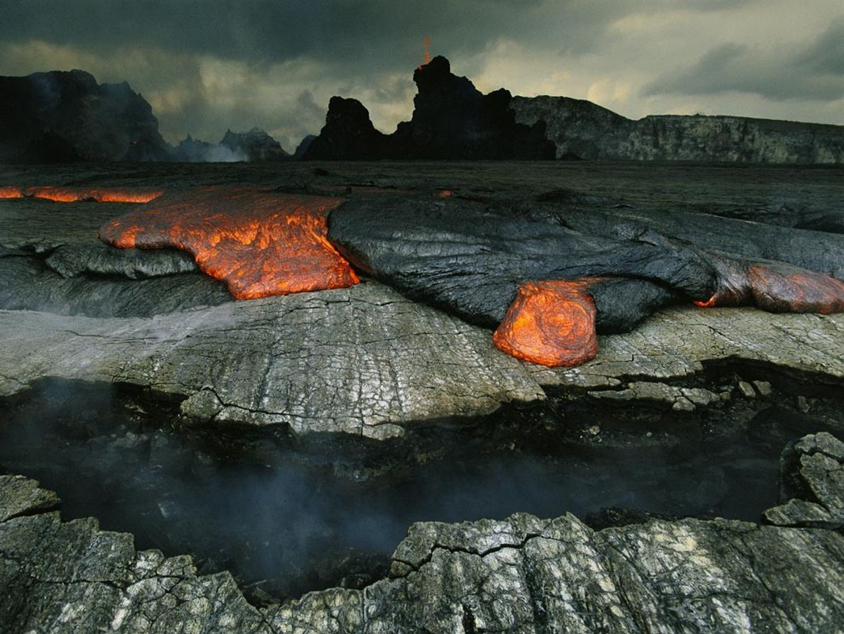 Oozing lava acts as a seal over fractured ground in Hawaii Volcanoes National Park. Once the ...