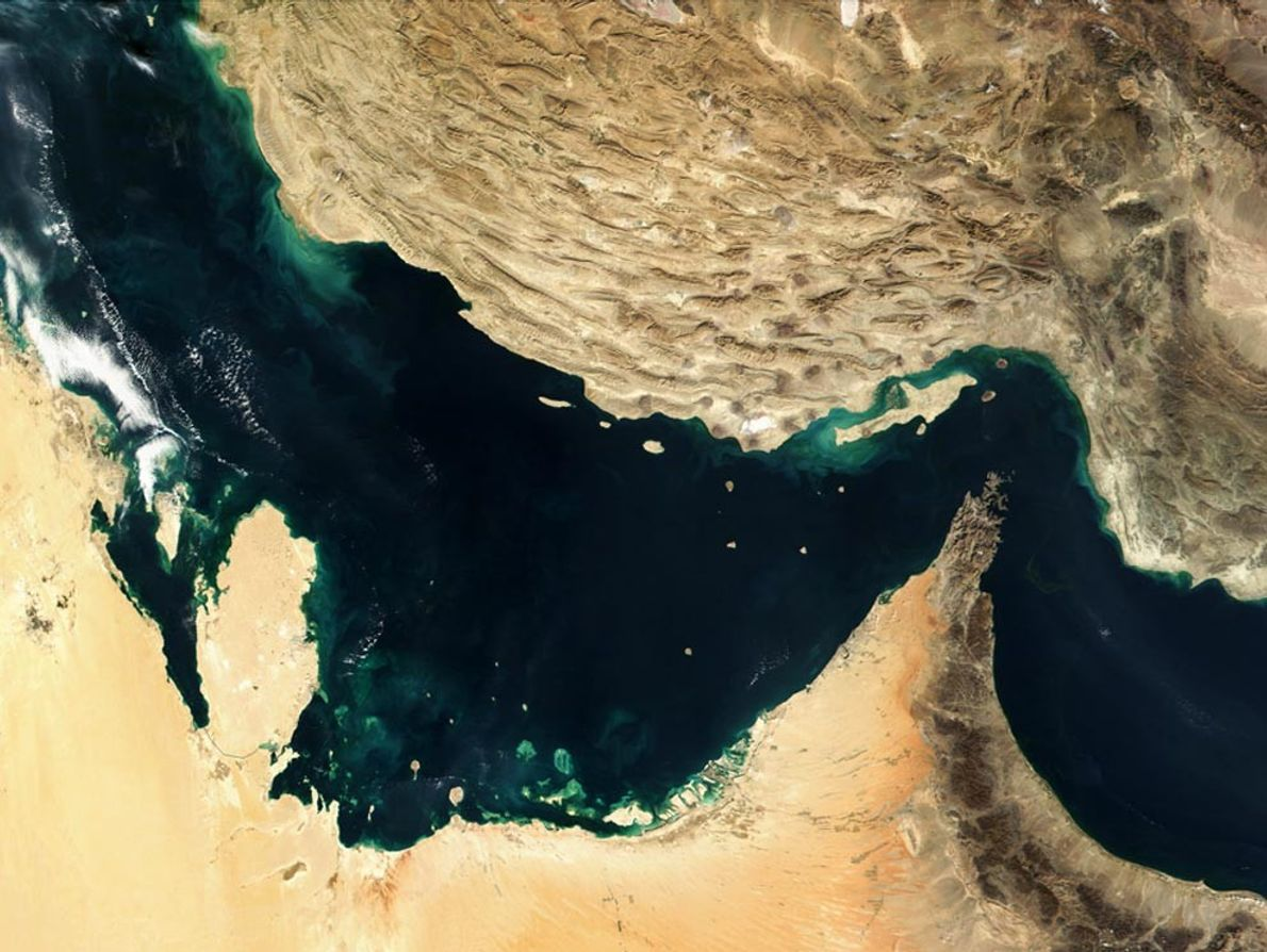 In the Persian Gulf, two tectonic plates collide. The Arabian plate (lower left) is running up ...